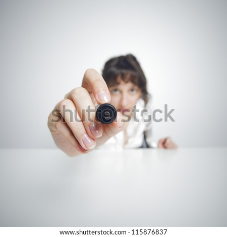 focused Businesswoman with pen