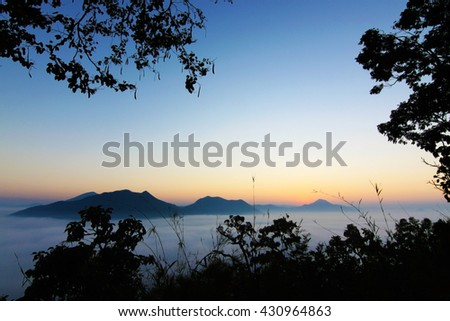 Fog and mountain valley landscape, Chiang Khan loei Thailand, Image contain certain grain or noise, soft focus.