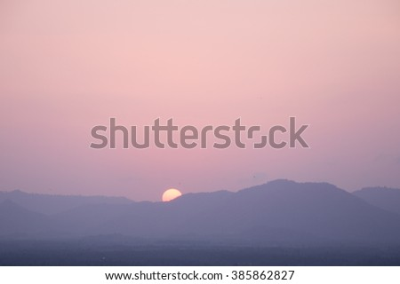 Foggy mountain during sunset