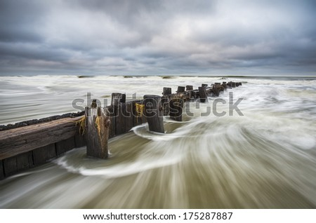 Folly Beach South Carolina Charleston SC Seascape landscape photography featuring moving ocean water against an old wooden erosion control breakwater