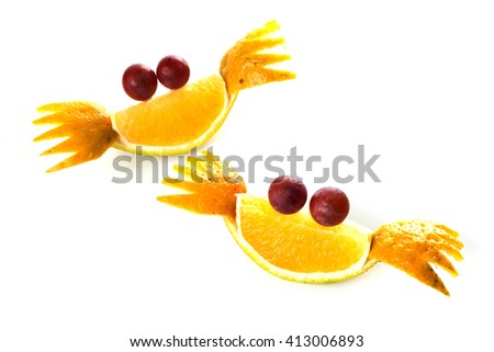Food art creative concepts. Cute crabs made of tangerines and grapes isolated on white background
