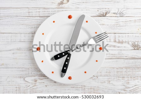 Food clock on white wooden background. Time to eat pasta.