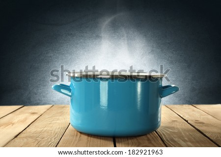 food photo of metal pot and light on wall