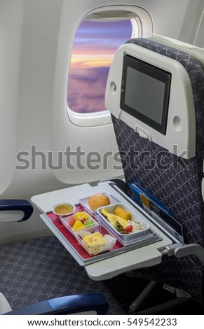 Food served on board of airplane on the table