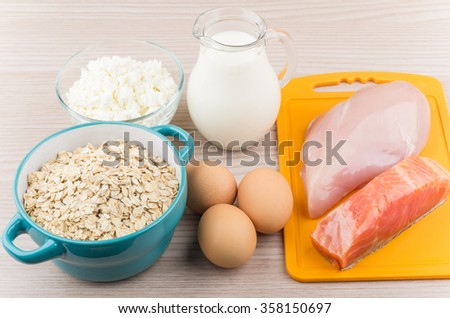 Foods rich in protein and carbohydrates on wooden table