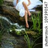foot in water in the forest .fairy tale - stock photo