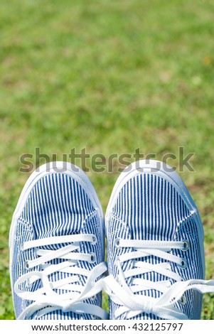 Foot on the green background