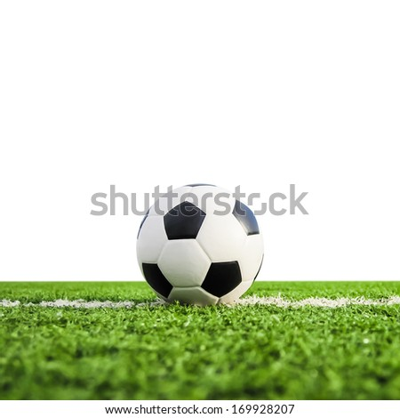 football on green grass isolated