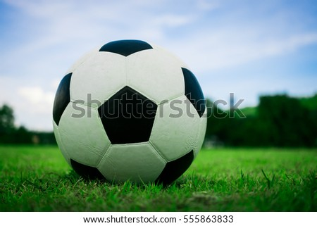 football/soccer ball on the field with blue sky