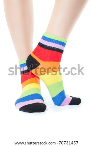 Foots in stripped socks over white