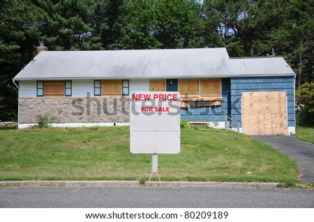For Sale Sign in front of Boarded Abandon Blue Shingle Residential Suburban Home Quick Sale