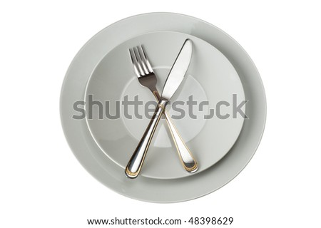 Fork And Knife on Plate Isolated On White Background