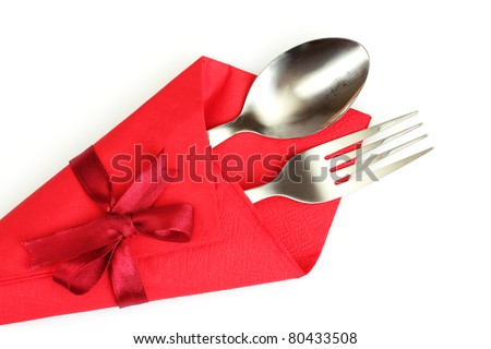 fork and spoon in red cloth, isolated on white
