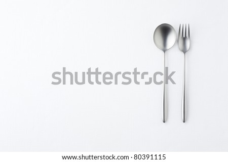 Fork and spoon on white background.