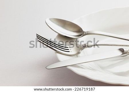 Fork, Spoon and Table Knife on the white background