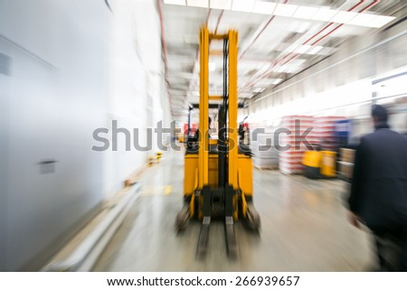 Forklift working at warehouse