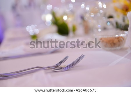 Forks placed on a table in restaurant