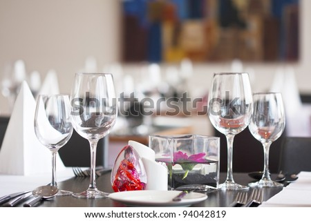 Formal dining table set up with flower in luxury restaurant