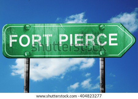 fort pierce road sign , worn and damaged look