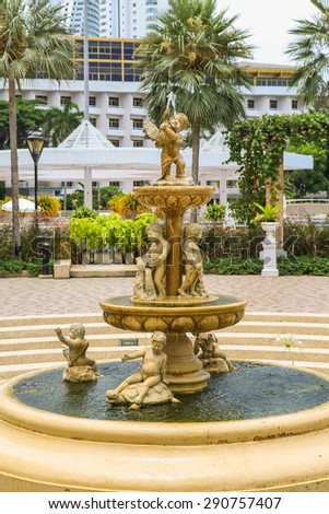 Fountain with little angels in the Ambassador hotel in south Pattaya.