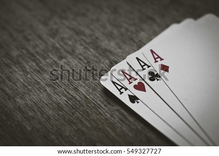 four aces playing cards on a wooden background. risk, luck, abstraction. Space for your text or object