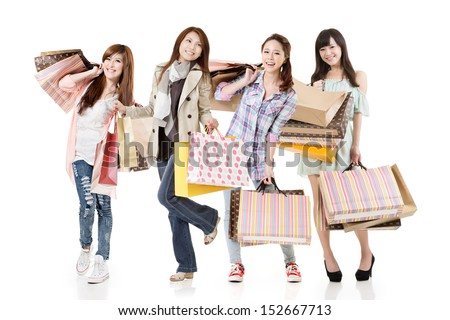 Four attractive young asian shopping women posing. Group full length portrait. Isolated on white background.