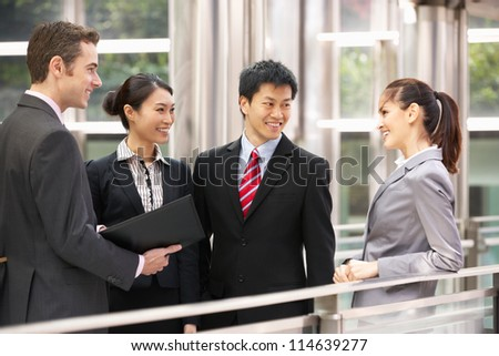 Four Business Colleagues Having Discussion Outside Office