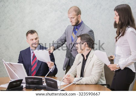 four businessmen discussing in the office documents
