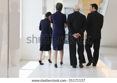Four businesspeople walking