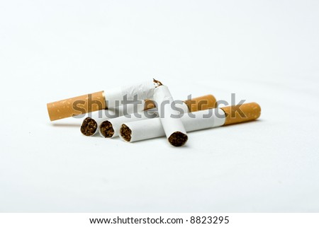 Four cigarets on white backgrounds