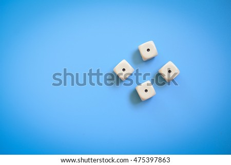 Four dice number one on a blue background