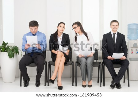 Four different people waiting for interview. Looking nervous