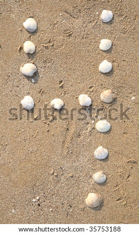 four digit symbol from shells in a sand