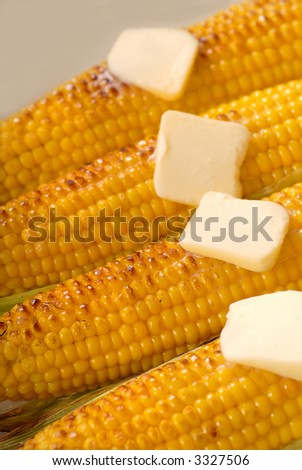 Four ears of roasted corn with melting butter