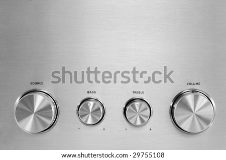 Four isolated gray hifi knobs from a stereo amplifier