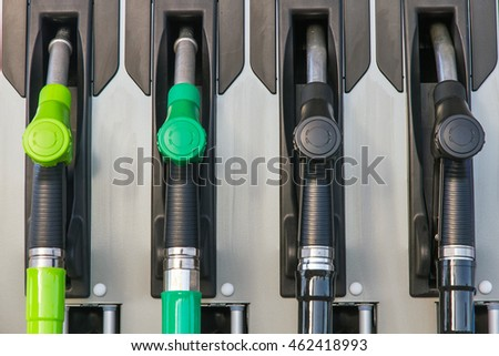 Four jet nozzles or hoses with tap for dispensing fuel
