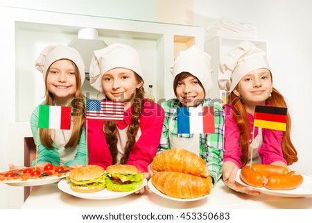 Four kids representing meal of different countries