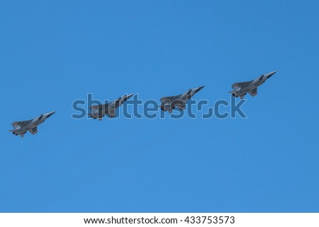 Four supersonic interceptor airplanes  MiG-31 in flight. Moscow, Russia, May, 9 2016. Blue sky in the background