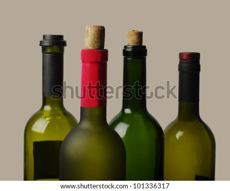 Four wine bottles on  brown