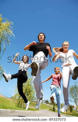 Four young people running
