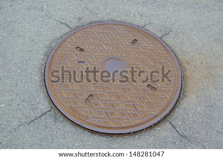 fragment manhole cover in the city