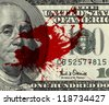 Fragment of 100 dollar bill with blood spots - stock photo