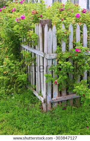 Fragment of old country fence. Exterior rural construction
