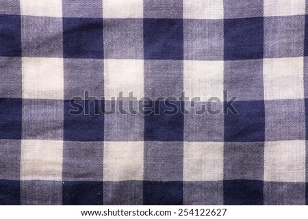 Fragment of the blue checkered shirt useful as background