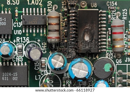 Fragment of the printed-circuit board with the microcircuit which has burned out on it