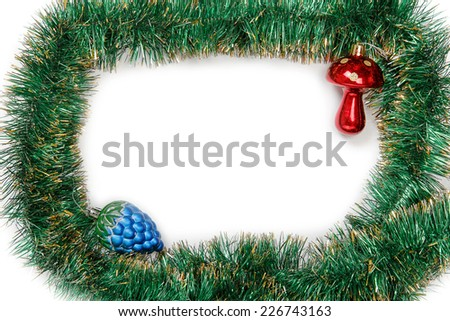 Frame of green Christmas garland with Christmas toys on a white background