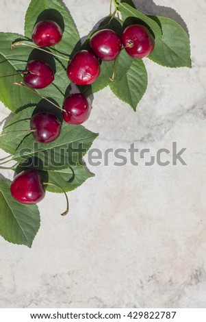 Frame with ripe cherries , the upper left corner , background, vertical