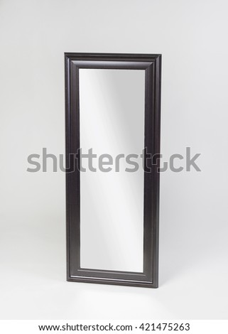 Framed mirror on gray background