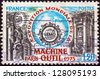 FRANCE - CIRCA 1975: A stamp printed in France issued for the 1st World Machine Tools Exhibition, Paris shows Machine Tools and Emblem, circa 1975. - stock photo