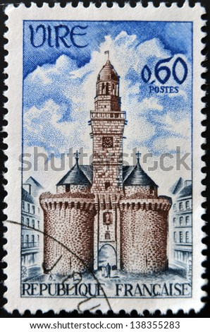 FRANCE - CIRCA 1967: A stamp printed in France shows Vire, The Gate and Clock Tower, circa 1967